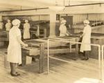 Production; knock out department; bar production; female employees catching molds, 1930-1935.'