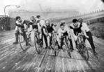 Image of men riding bicycles on a track.