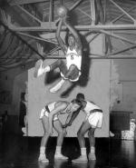 Overbrook High School's Wilt Chamberlain makes shot in game against Southern High School.