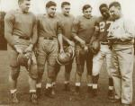 Willie Thrower with his Michigan State teammates, in uniform, and Coach Biggie Mann.