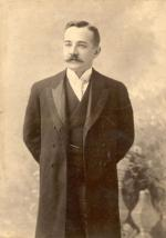 Milton S. Hershey, wearing suit; 3/4 length portrait