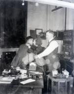Dr.Thomas is shown in photo broadcasting from the Westinghouse Station to East Pittsburgh- station KDKA -the heart palpitations of the lover's kiss.