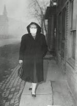 Woman Wearing Surgical Mask While Strolling on the Street.