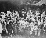 Dr. John Alfred Brashear stands, surrounded by a group of young children, c.1914