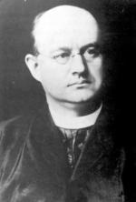 Black and white image of the Rev.Murgas in his Clerical Clothing.