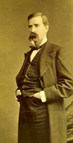 James Donald Cameron, senator from Pennsylvania, three-quarter length portrait, standing, facing left.