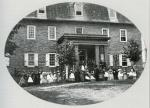 Photograph of a Linden Hall student body standing in front a brick building.