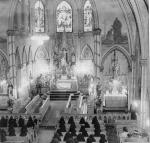 The interior of the ornate college chapel, with nuns at prayer during the school day.