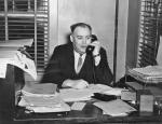 Local 506 Business Agent James Kennedy at desk on telephone.