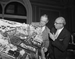 Clinton Anderson, (left), and Lewis L. Strauss examine a photograph of America's first full scale commercial power plant, under construction at Shippingport, PA, May 24, 1956.