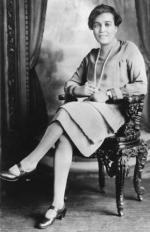 Jessie Redmon Fauset; full length, seated, facing slightly left