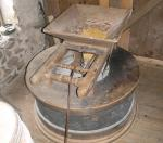 The millstone furniture with corn in the hopper
