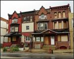 Row houses on a Philadelphia street. Coltrane's home has the historical marker directly in front of the home.