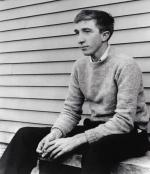 John Updike seated