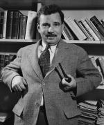 Malcolm Cowley Standing with Pipe