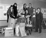 Group Posing with Boxes and Holding Bread(L to R): Adelaide Walker, Melvin Levy, Malcolm Cowley (front row); Polly Boyden, Mary Heaton Vorse, Liston M. Oak, and Charles R. Walker (rear row). Seated is Belle Keller.