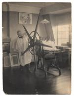 Pennell in his studio with printing press.