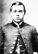 Black and white image of a young man in uniform.