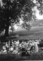 Black and white image of students creating paintings of the landscape