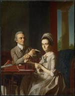 Portrait of Sarah Mifflin, dressed in a formal off white gown wearing a corsage and a feminine lace cap. She is sitting at her desk, holding a quill. Her husband, Thomas Mifflin sits on the opposite side of the desk in formal dress and holding a book, while gazing lovingly at his wife.