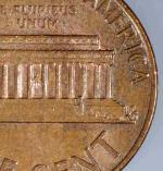 Rear side of penny with Gasparro's initials