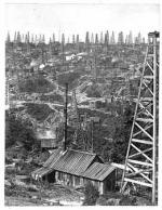 A lack of knowledge about geology led oil prospectors to drill wells virtually anywhere, and to drill many wells at a productive site. Triumph Hill, near Tidioute, Warren County, boasted the highest density of wells in the oil region. Fifty derricks can be seen in this view.'