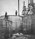 The technology to store and transport oil lagged behind drilling technologies. Round wooden storage tanks with iron hoops, although an improvement over the previous box shaped vats, were still problematic: they leaked, and were a fire hazard. Iron tanks were in use as early as 1862, but the shift to these tanks was delayed by iron shortages caused by the Civil War.'