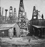 Early oil fields had storage tanks and company buildings close to the oil derricks, as shown in this photo of Bennehoff Run. The danger of this setup was demonstrated when lightning struck a pipe at Bennehoff in July 1866, igniting an adjacent tank. The tank exploded almost immediately, releasing burning oil down the run, and destroying as many as 30 derricks and adjacent tanks.'