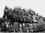 Image of dozens of men atop a locomotive