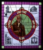 This stained glass window in the Mother Bethel A.M.E. Church illustrates the history of the church, and includes a portrait of its founder, Richard Allen.