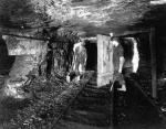 Both workers in this 1916 photograph lost their left legs in mining accidents.