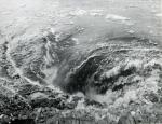 A close-up photo of a large whirlpool in the Susquehanna River, caused by a 1959 mine collapse.