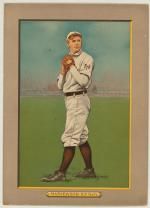 Baseball card, full length, in wind-up.