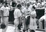 Black and white baseball card depicting a young female fan seeking autographs from the Connecticut team.'