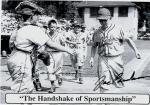 Black and white baseball card of a runner coming into home while the catcher offers his outstretched hand to congratulate the runner.'