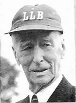Black and white baseball card of Connie Mack sporting a Little League cap.'