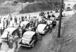 Enthusiastic travelers line up with their cars for opening day on the Pennsylvania