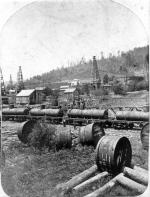 Railroads, loading tank cars from pipe lines, Densmore tanks in the foreground, Bradford Oil Field, 1876-7, Frank Robbins, photographer