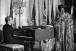 Richard Nixon plays the piano as Pearl Bailey sings.