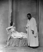 Paul Robeson as Othello, standing over English actress Peggy Ashcroft as Desdemona. London, 1930.
