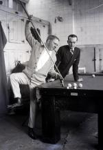 Fields is pictured here learning some of the tricks of the billiard table.