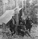 In this 1864 photograph, Major General Winfield Scott Hancock, seated, poses with John Gibbon, F.C. Barlow and William Birney, three of his friends, division commanders all, poses near the site of the battle of Cold Harbor.
