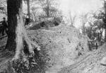 Further excavation of the mound. The white bearded individual with vest is probably Thomas Harper; the individual digging atop the mound may be Frank H. Gerrodette; note the size of the tree growing in the mound.