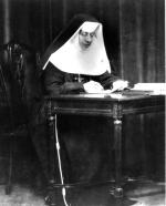 Black and white photograph of Sister Katharine Drexel working at her desk.
