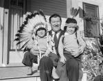 In this 1932 photograph, Thorpe's sons, Phil and Billy, have been cast in the role of stereotypical Indians.