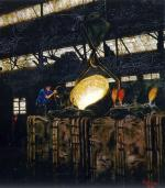 Dark oil on canvas depicting a steel worker and the interior of a foundry. '