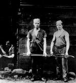 Image of two steel workers.