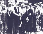 Secretary of Labor Frances Perkins shakes hands with Carnegie Steel Workers during the National Recovery Act drive under FDR's administration. 1933