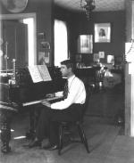 Ethelbert Woodbridge Nevin sitting at the piano.