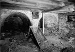 Black and white image of the arched brick ovens inside of the Thomas Massey House